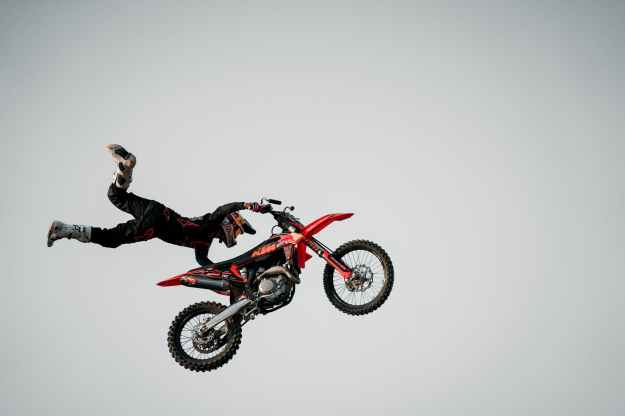 man performing stunt on motorcycle