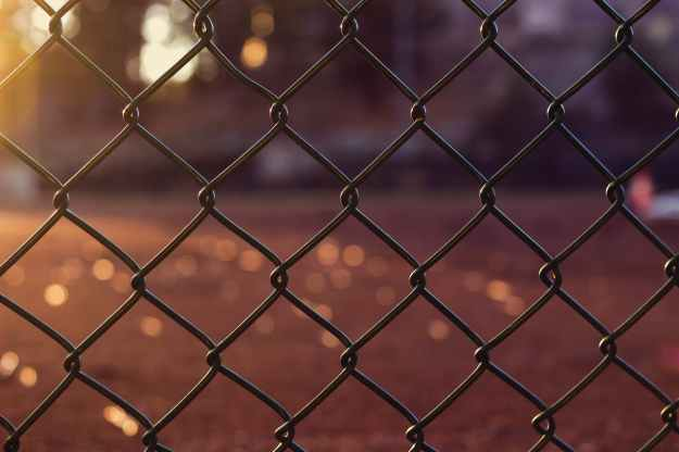 gray metal chain link fence close up photo