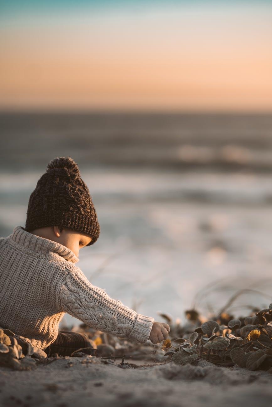 photo of child wearing knit sweater